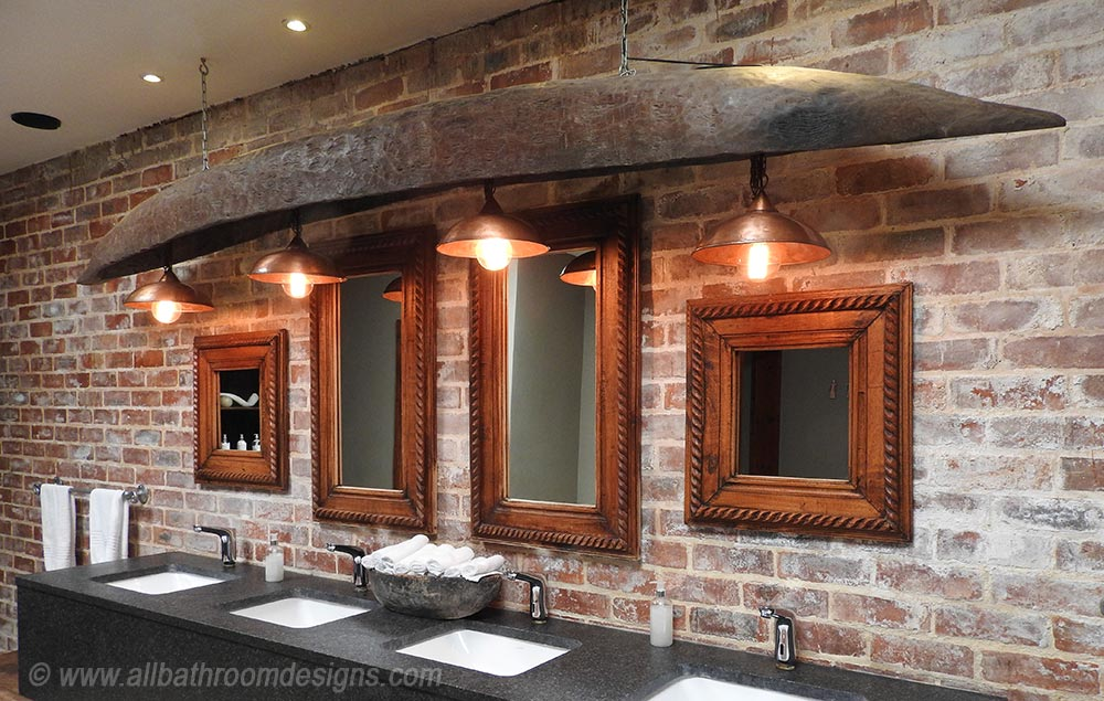 vanity with copper lights and wooden canopy