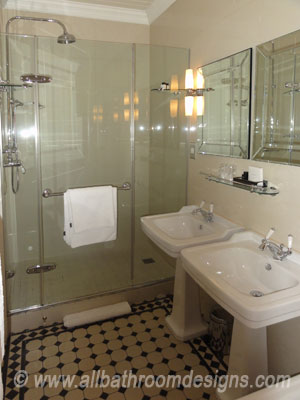 dual basins and glass enclosed shower