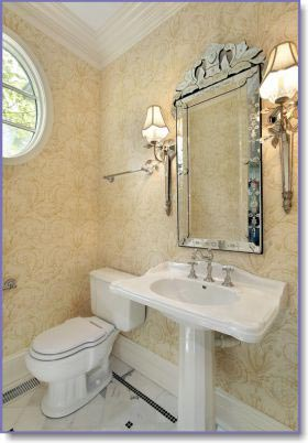 silver vanity mirror and wall sconces